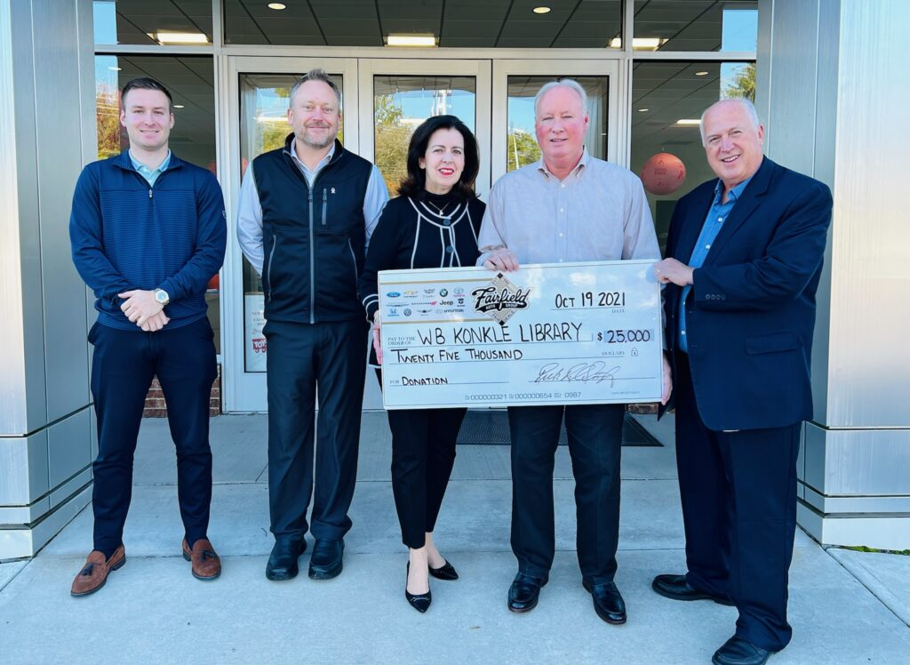konkle library receiving giant check from fairfield auto group